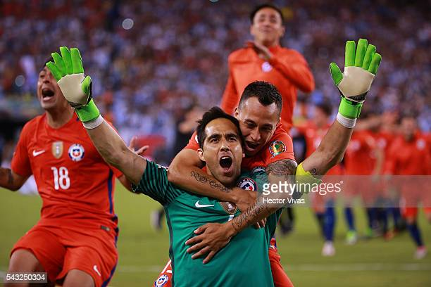 Claudio Bravo of Chile celebrates with teammate Fabian Orellana during the championship match between Argentina and Chile at MetLife Stadium as part...