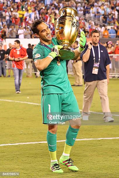 Claudio Bravo of Chile celebrates with the trophy after winning the championship match between Argentina and Chile at MetLife Stadium as part of Copa...