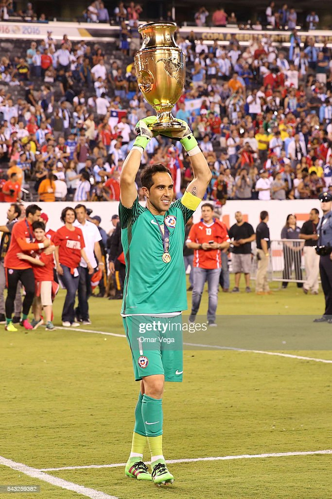 Claudio Bravo of Chile celebrates with the trophy after winning the championship match between Argentina and Chile at MetLife Stadium as part of Copa America Centenario US 2016 on June 26, 2016 in East Rutherford, New Jersey, US.