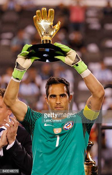 Claudio Bravo of Chile holds up the Golden Glove Award following the championship match between Argentina and Chile at MetLife Stadium as part of...