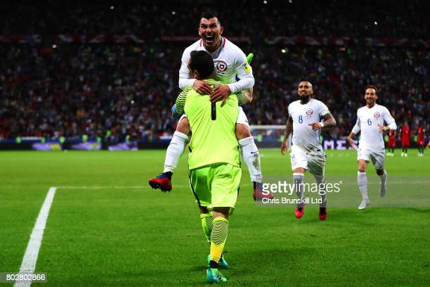 Claudio Bravo of Chile is congratulated by teammate Gary Medel after the penalty shoot out following the FIFA Confederations Cup Russia 2017...