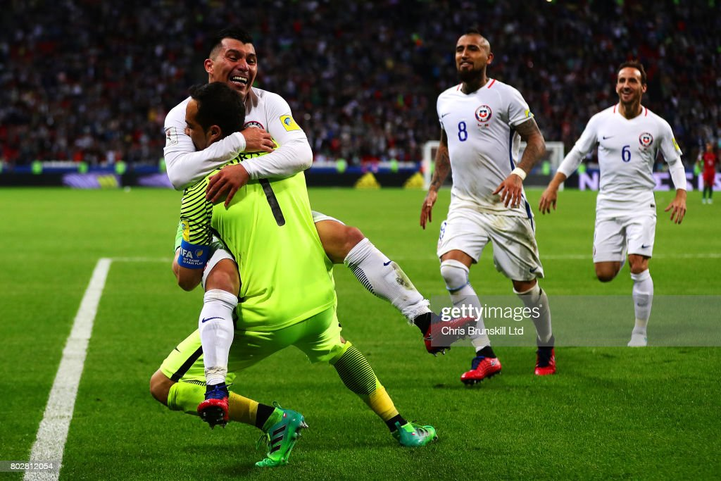 Claudio Bravo of Chile is congratulated by team-mate Gary Medel after the penalty shoot out following the FIFA Confederations Cup Russia 2017 Semi-Final match between Portugal and Chile at Kazan Arena on June 28, 2017 in Kazan, Russia.