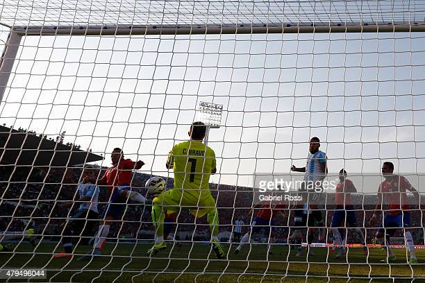 Claudio Bravo of Chile makes a save after Sergio Aguero of Argentina heads to target during the 2015 Copa America Chile Final match between Chile and...