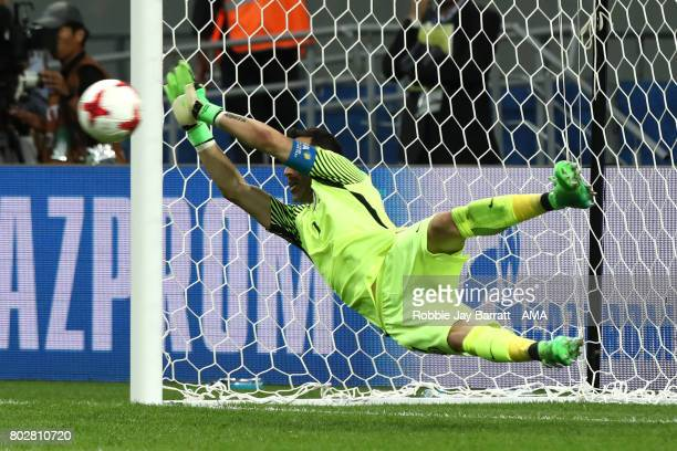 Claudio Bravo of Chile saves a penalty in a shootout during the FIFA Confederations Cup Russia 2017 SemiFinal match between Portugal and Chile at...