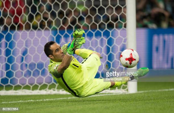 Claudio Bravo of Chile saves a penalty in the extratime shootoutduring the FIFA Confederations Cup semifinal match between Portugal and Chile at...
