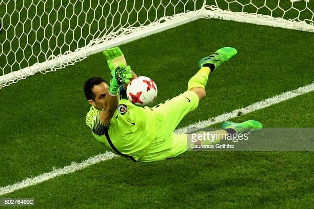 Claudio Bravo of Chile saves Portugal first penalty from Ricardo Quaresma of Portugal during the FIFA Confederations Cup Russia 2017 SemiFinal...