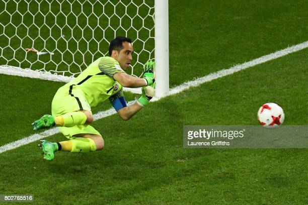 Claudio Bravo of Chile saves Portugal's third penalty during the penalty shoot out during the FIFA Confederations Cup Russia 2017 SemiFinal between...