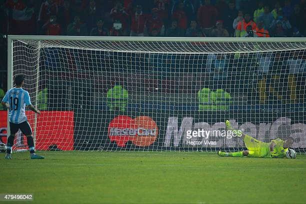 Claudio Bravo of Chile saves the third penalty kick shooted by Ever Banega of Argentina in the penalty shootout during the 2015 Copa America Chile...