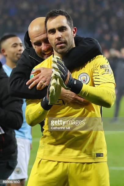 Claudio Bravo of Manchester City and Josep Guardiola Manager of Manchester City celebrate penalty shoot out victory after the Carabao Cup...