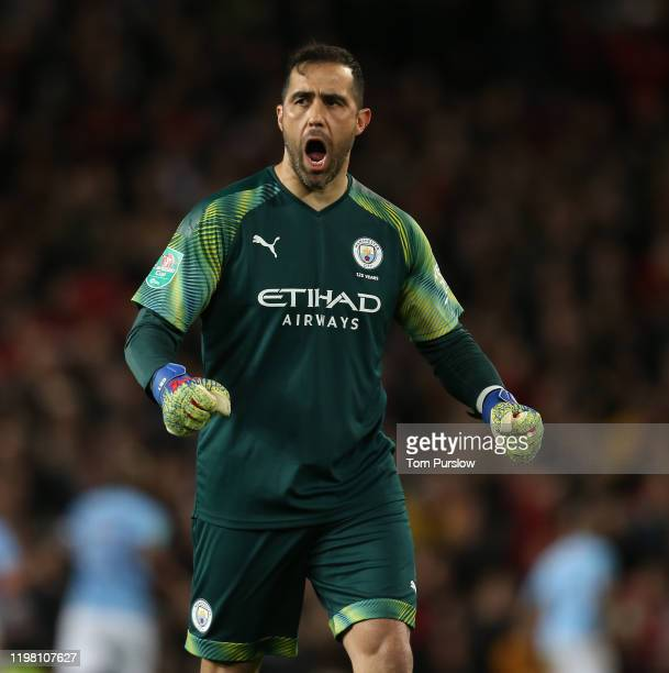 Claudio Bravo of Manchester City celebrates Bernardo Silva scoring their first goal during the Carabao Cup Semi Final match between Manchester United...