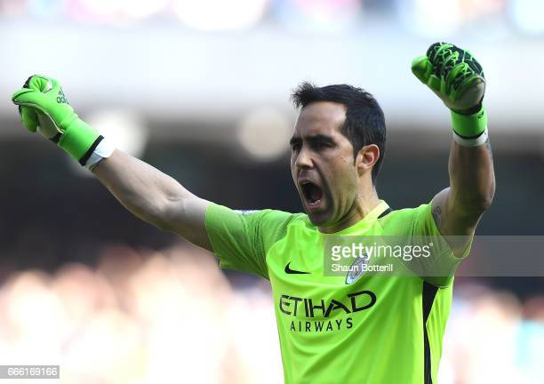 Claudio Bravo of Manchester City celebrates his sides third goal during the Premier League match between Manchester City and Hull City at Etihad...