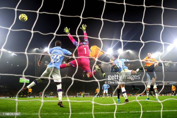 Claudio Bravo of Manchester City clears the ball under pressure from Fernandinho of Manchester City during the Premier League match between...