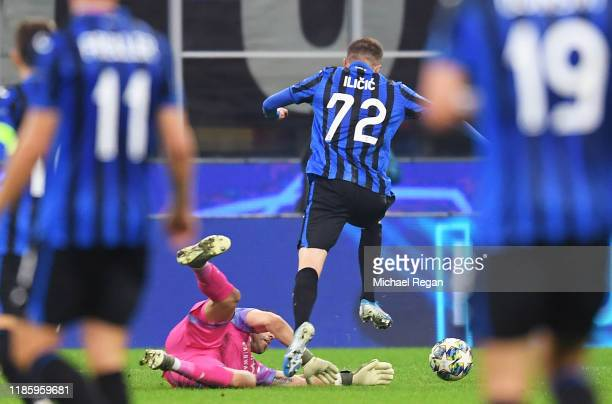 Claudio Bravo of Manchester City fouls Josip Ilicic of Atalanta resulting in being given a red card during the UEFA Champions League group C match...
