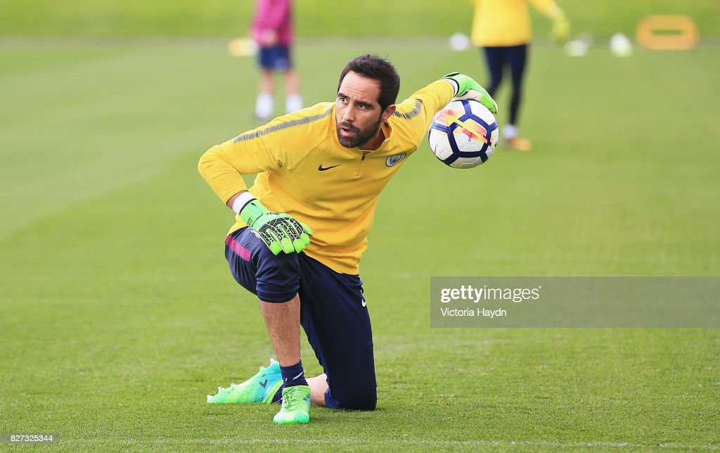 Fotos e imgenes de manchester city training session getty images claudio bravo of manchester city in action during a training session at etihad campus on august voltagebd Image collections