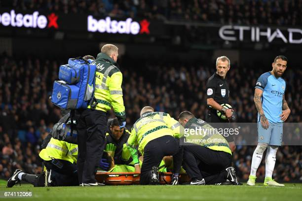 Claudio Bravo of Manchester City is given treatment following an injury during the Premier League match between Manchester City and Manchester United...