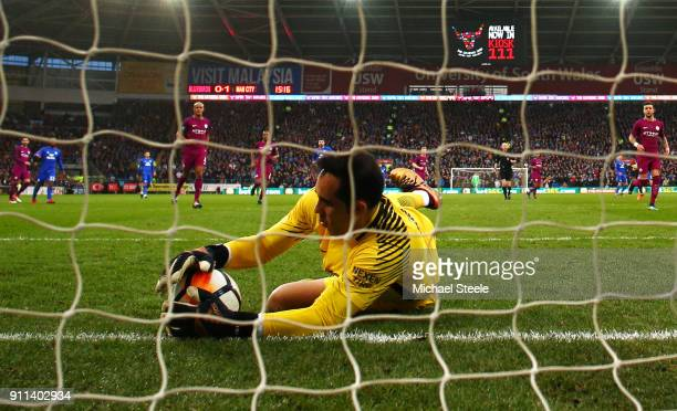 Claudio Bravo of Manchester City makes a save on the line during The Emirates FA Cup Fourth Round match between Cardiff City and Manchester City on...