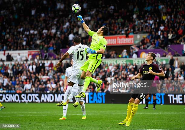 Claudio Bravo of Manchester City punches the ball away during the Premier League match between Swansea City and Manchester City at the Liberty...