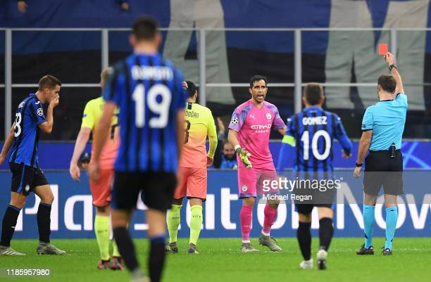 Claudio Bravo of Manchester City receives a red card from referee Aleksei Kulbakov during the UEFA Champions League group C match between Atalanta...