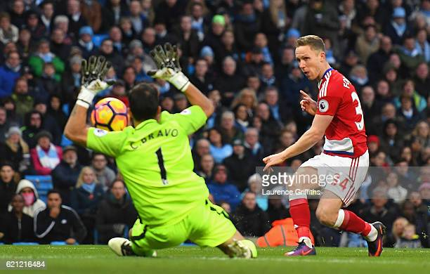 Claudio Bravo of Manchester City saves a shot from Adam Forshaw of Middlesbrough during the Premier League match between Manchester City and...