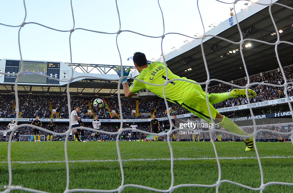 Claudio Bravo of Manchester City saves Erik Lamela of Tottenham Hotspur penalty during the Premier League match between Tottenham Hotspur and Manchester City at White Hart Lane on October 2, 2016 in London, England.