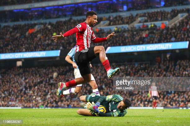 Claudio Bravo of Manchester City saves the ball from Lys Mousset of Sheffield United during the Premier League match between Manchester City and...