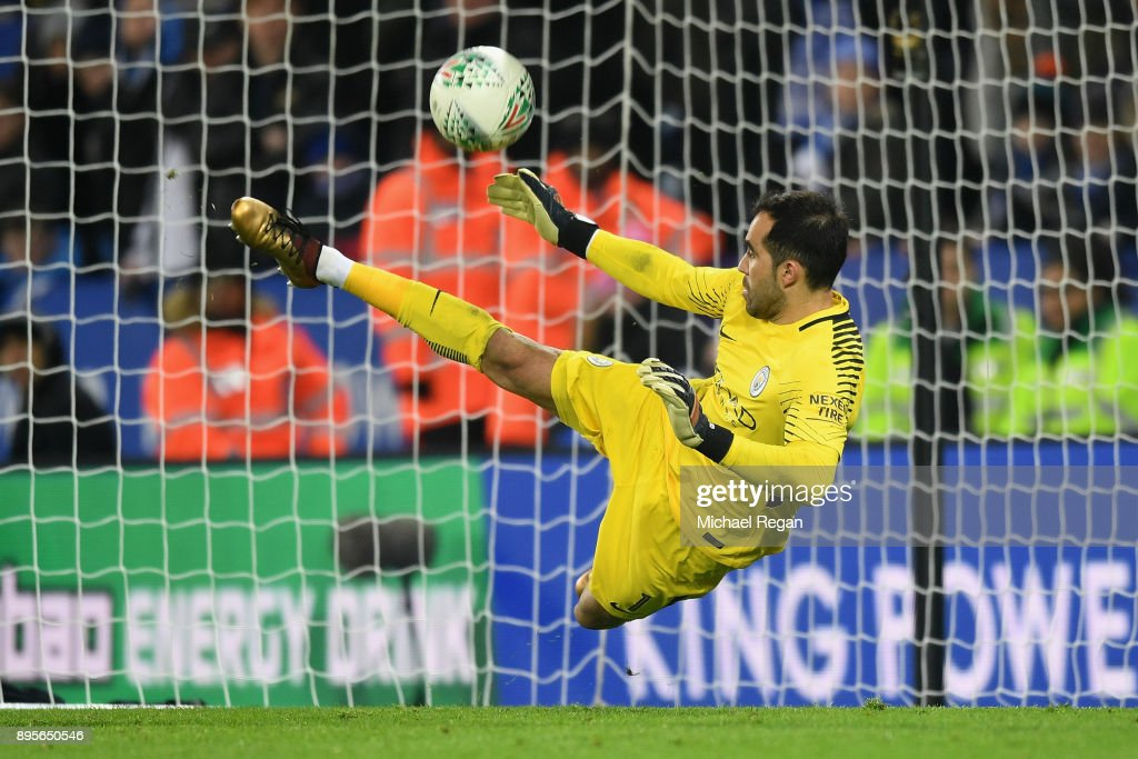 Claudio Bravo of Manchester City saves the decisive penalty in the shoot out from Riyad Mahrez of Leicester City during the Carabao Cup Quarter-Final match between Leicester City and Manchester City at The King Power Stadium on December 19, 2017 in Leicester, England.