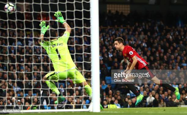 Claudio Bravo of Manchester City watches on as Ander Herrera of Manchester United misses the target from a close range header during the Premier...