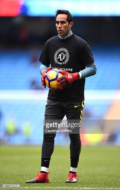 Claudio Bravo of Manchester City wearing a tshirt to commemorate the victims of the plane crash involving the Brazilian club Chapecoense warms up...