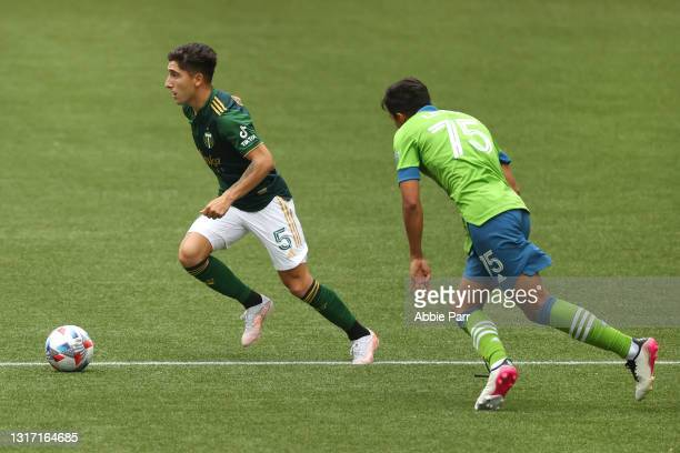 Claudio Bravo of Portland Timbers controls the ball against Danny Leyva of Seattle Sounders in the second half at Providence Park on May 09, 2021 in...