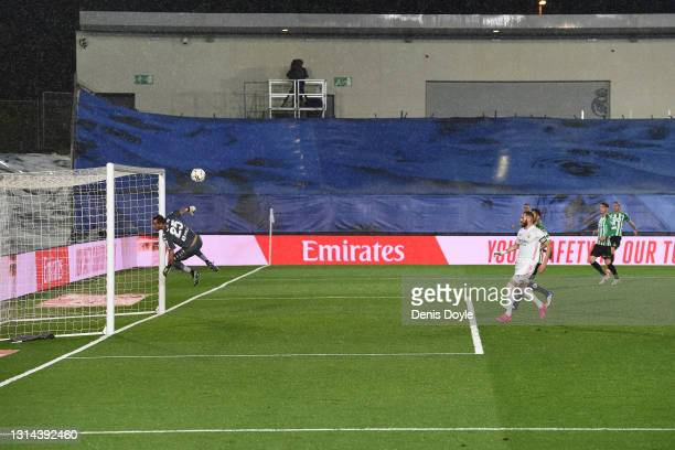 Claudio Bravo of Real Betis Balompie and Karim Benzema of Real Madrid react after the ball struck the bar from a cross during La Liga Santander match...