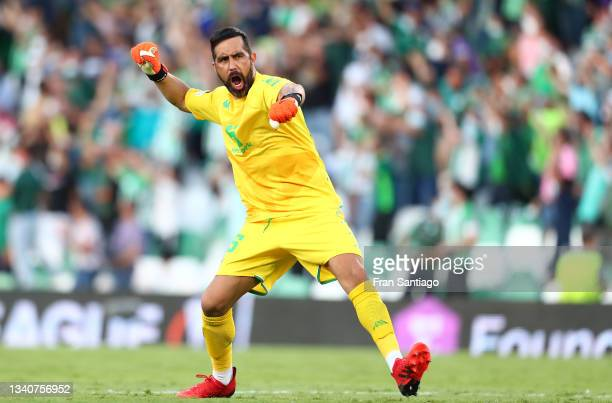 Claudio Bravo of Real Betis celebrates their side's fourth goal scored by Juanmi of Real Betis during the UEFA Europa League group G match between...