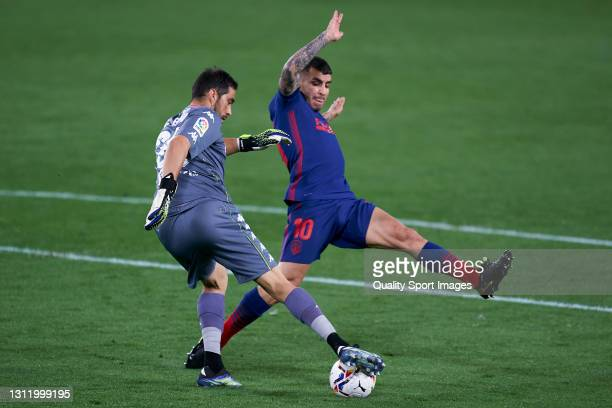 Claudio Bravo of Real Betis competes for the ball with Angel Correa of Atletico de Madrid during the La Liga Santander match between Real Betis and...