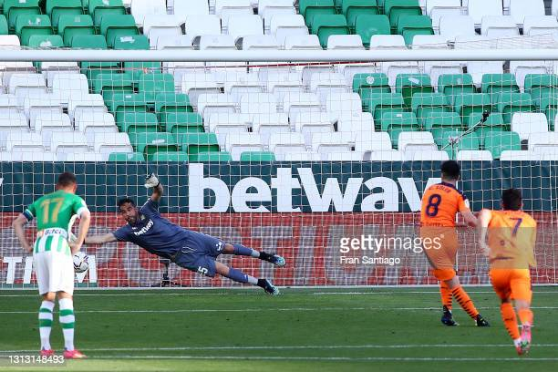 Claudio Bravo of Real Betis fails to save as Carlos Soler of Valencia CF scores their team's second goal from the penalty spot during the La Liga...