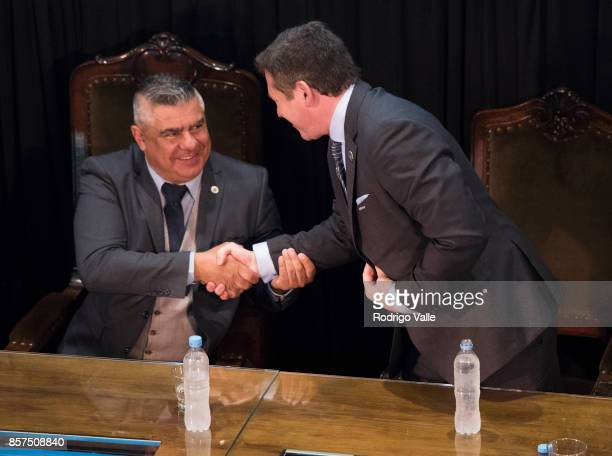 Claudio Chiqui Tapia president of AFA and Alejandro Dominguez of CONMEBOL shake hands during a press conference at AFA as part of the official visit...