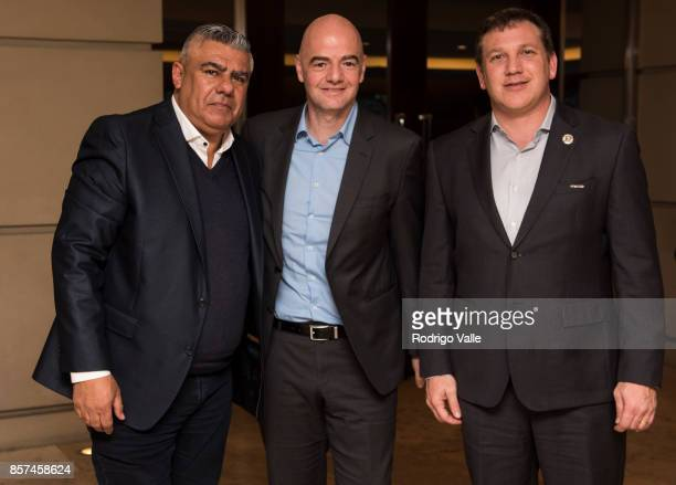 Claudio Chiqui Tapia president of AFA Gianni Infantino president of FIFA and Alejandro Dominguez president of CONMEBOL pose for a photo as they...