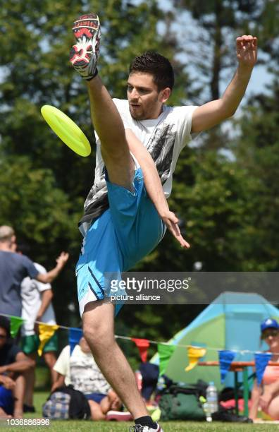 Claudio Cigna of Italy catches a disc in an acrobatic manner during the FPA Freestyle Disc World Championships in Karlsruhe, Germany, 25 June 2015....