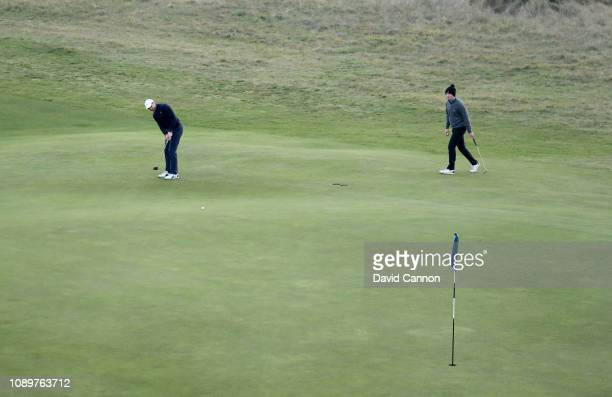 Claudio Consul of Worcester College Oxford putts on the green on the ninth hole with the flagstick in in his match against Alex Gems of Somerville...