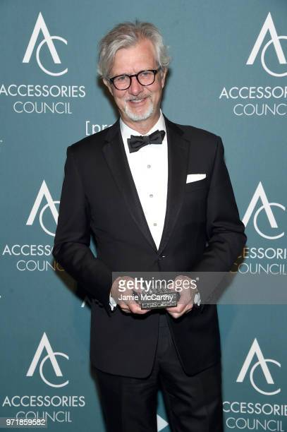 Claudio Del Vecchio poses with an award backstage at the 22nd Annual Accessories Council ACE Awards at Cipriani 42nd Street on June 11 2018 in New...