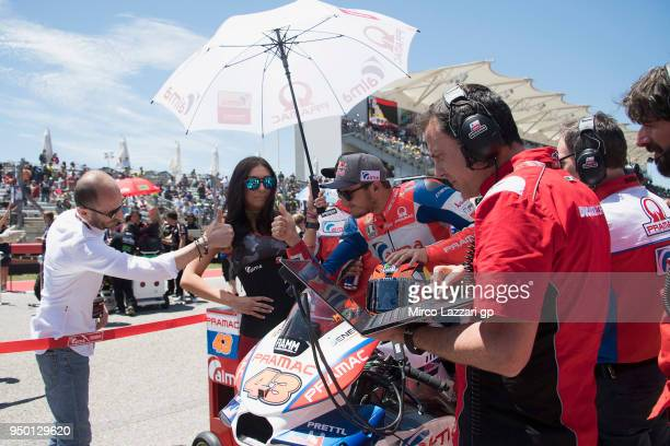 Claudio Domenicali of Italy and CEO Ducati Factory greets Jack Miller of Australia and Pramac Racing prepares to start on the grid during the MotoGP...