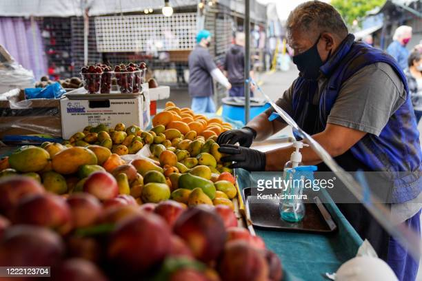 Claudio Eclicerio organizes fruits at his stand at the Santa Fe Springs Swap Meet on Saturday, June 20, 2020 in Santa Fe Springs, CA. Swap Meets...