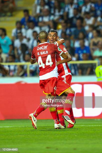Claudio Falcao of Desportivo das Aves /R celebrates scoring CD Aves first goal with Vitor Gomes of Desportivo das Aves and Diego Galo of Desportivo...