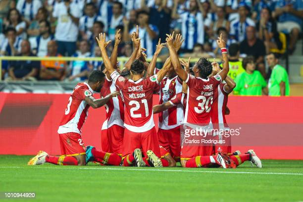 Claudio Falcao of Desportivo das Aves wcelebrates scoring CD Aves first goal with his team mates during the Portuguese Super Cup match between FC...