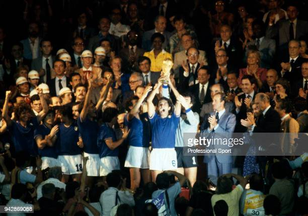 Claudio Gentile of Italy lifts the World Cup after the FIFA World Cup Final between Italy and West Germany at the Santiago Bernabéu Stadium on July...
