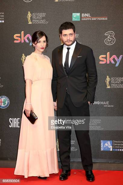 Claudio Giovannesi and a guest walk the red carpet of the 61 David Di Donatello on March 27 2017 in Rome Italy