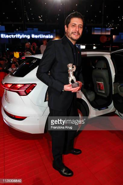 Claudio Giovannesi poses in front of Audi etron car for the closing ceremony of the 69th Berlinale International Film Festival Berlin at Berlinale...