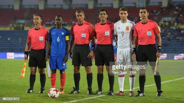 Claudio Gomes of France and Abel Ruiz of Spain pose for photos with referees prior to the FIFA U17 World Cup India 2017 Round of 16 match between...