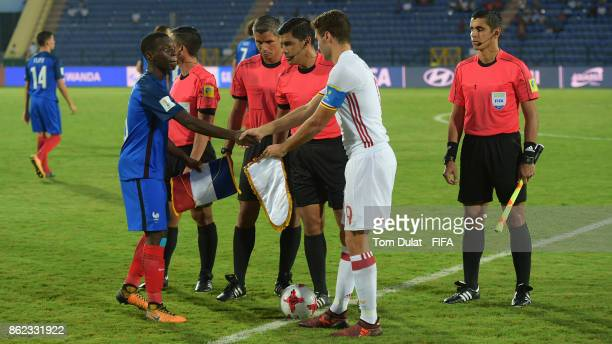 Claudio Gomes of France and Abel Ruiz of Spain shake hands prior to the FIFA U17 World Cup India 2017 Round of 16 match between France and Spain at...
