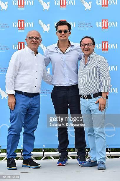 Claudio Gubitosi Orlando Bloom Piero Rinaldi attend Giffoni Film Festival 2015 Day 9 photocall on July 25 2015 in Giffoni Valle Piana Italy