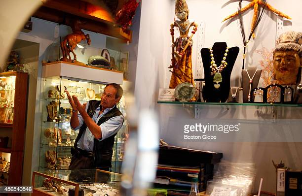Claudio Kraus owner of Geoclassics speaks to a customer inside his store in Faneuil Hall marketplace in Boston on September 22 2014