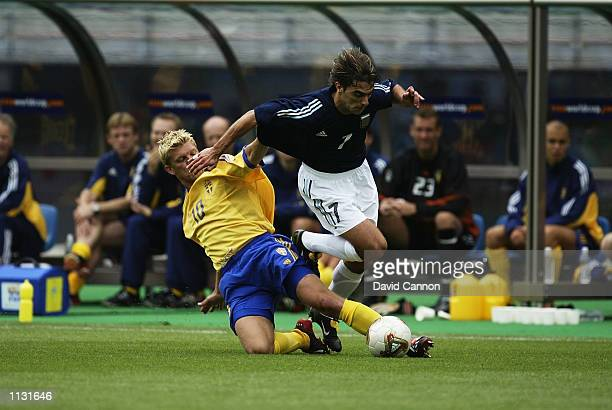 Claudio Lopez of Argentina is challenged by Marcus Allback of Sweden during the Argentina v Sweden Group F World Cup Group Stage match played at the...